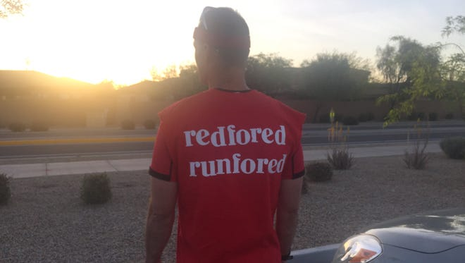 Physical-education teacher Landon Benson shows off his #RedForEd t-shirt before taking off for his 26.2-mile run in support of the grassroots movement.