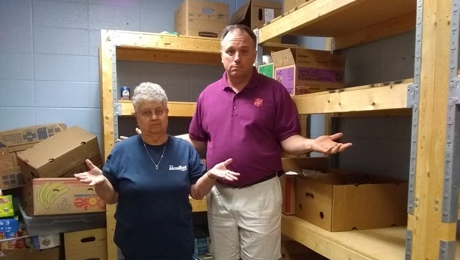 Salvation Army Social Services Director Ron Jacobson stands with Brown Bag Lunch Coordinator Barb Thill in the Brown Bag Lunch supply closet, three weeks after the start of the 2018 Brown Bag Lunch season.
