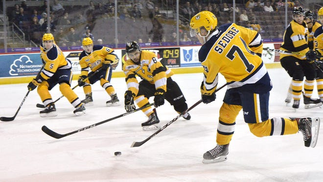 Erie Otters forward Noah Sedore, right, takes a shot against the Kingston Frontenacs in the first period at Erie Insurance Arena in Erie on Oct. 5, 2019. The OHL plans to return to play on Dec. 1 and hold a 64-game regular season.