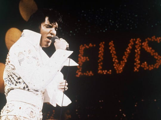 Elvis Presley in concert in 1972, during his jumpsuit era.