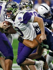 Washington quarterback Jake Browning (3) is sacked by Penn State defensive end Yetur Gross-Matos during the second half of the Fiesta Bowl NCAA college football game, Saturday, Dec. 30, 2017, in Glendale, Ariz. (AP Photo/Ross D. Franklin)