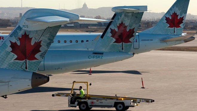 In this file photo from March 23, 2012, Air Canada planes sit at Montreal's Pierre Trudeau International Airport.