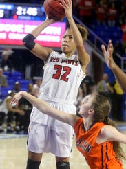 Stewarts Creek's Brianah Ferby (32) goes up for a shot