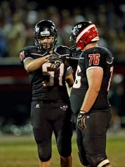 Ludlow defensive linemen Jacob Bridges and Tristan