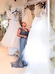 Mia Hart looking at bridal gowns at Elizabeth's Bridal