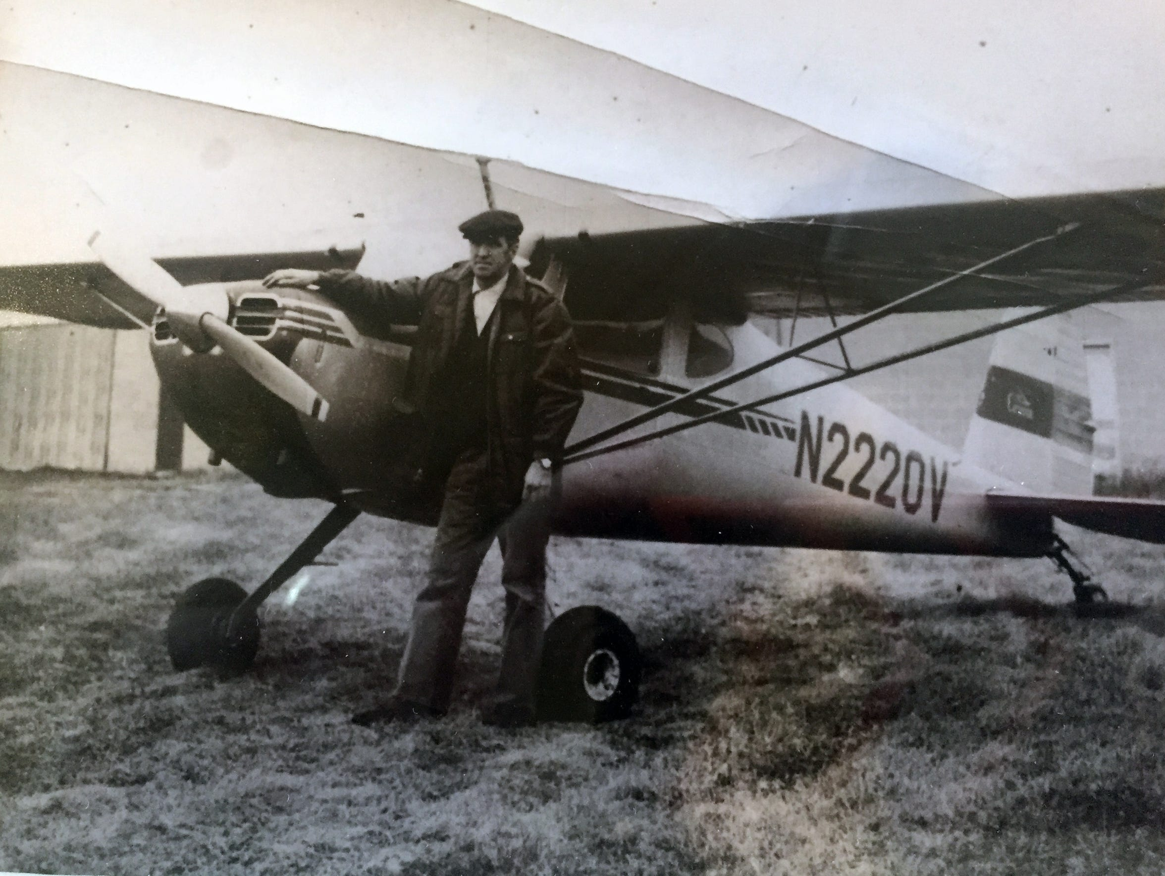 Richard Jerow, who flew over Lambeau Field on the day of the Ice Bowl Dec. 31, 1967, poses with his Cessna 140 plane.