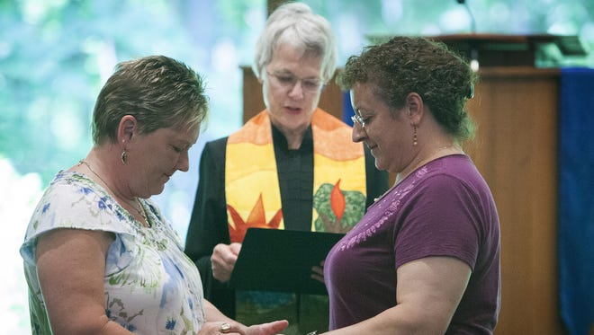 Kimberly Cox and Angelique Hartman took advantage of a legal window created by a federal ruling on Indiana's same sex marriage ban and were married in a ceremony at the Unitarian Universalist Church in Muncie on Thursday, June 26, 2014.