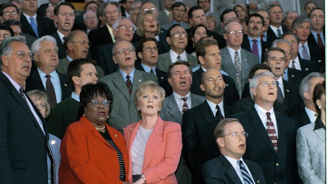 """House and Senate members sing """"God Bless America"""" from the steps of the U.S. Capital after a statement of unity on Sept. 11, 2001"""
