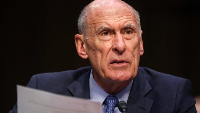 """In this March 6, 2018, file photo, Director of National Intelligence Dan Coats testifies before the Senate Armed Services Committee on Capitol Hill in Washington. Coats warned July 13, 2018, that cyber threat warnings are """"blinking red"""" with daily attempts by Russia and other foreign actors trying to undermine American democracy as well as water, aviation and electric systems."""