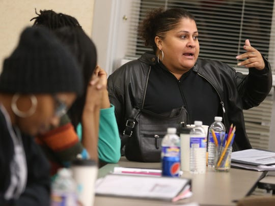 """Doris Carrasquillo, Rochester, talks about the boundaries of different """"communities"""" at the Parent Leadership Training Initiative class held in downtown Rochester Monday, Dec. 5, 2016."""