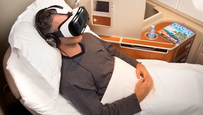 An undated image of passenger using the Samsung Gear VR headsets that Qantas plans to test as in-flight entertainment for first-class fliers.