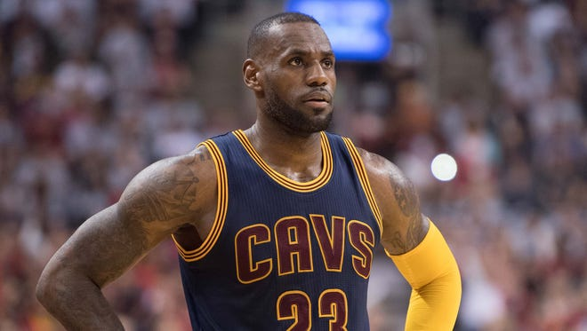 LeBron James looks on during the second quarter in game three of the Eastern conference finals of the NBA Playoffs against the Toronto Raptors.