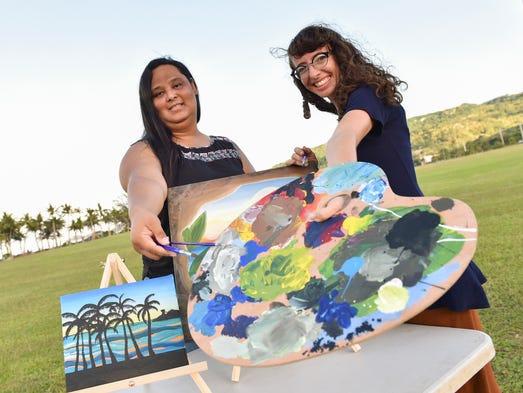 """Art in the Park"" coordinators Kina Lewis, left, and"