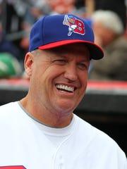 Buffalo Bills head coach Rex Ryan smiles after throwing
