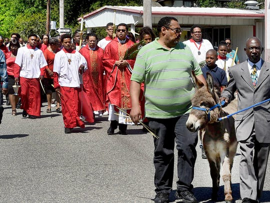 Holy Ghost Catholic Church parishoners make their way