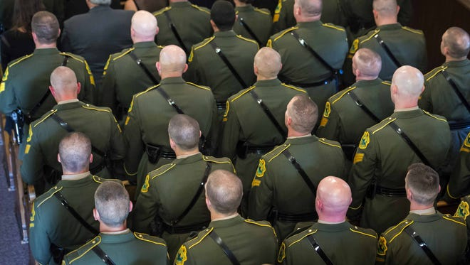 Members of the Vermont State Police attend funeral services for VSP trooper Kyle Young in Brownville N.Y. on Wednesday, September 23, 2015.