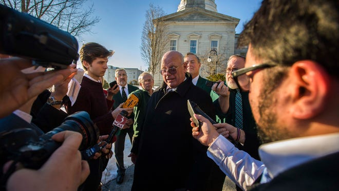 Sen. Norm McAllister, R-Franklin, answers questions outside the Statehouse in Montpelier after being suspended by the Senate on Wednesday, January 6, 2016.