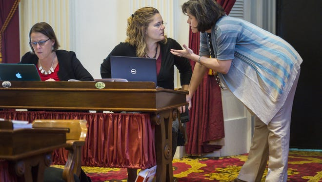 Rep. Mitzi Johnson, D-South Hero, right, Chairwoman of the House Appropriations Committee, confers with House Democratic Leader Rep. Sarah Copeland-Hanzas, D-Bradford, at the Statehouse in Montpelier on Friday, May 6, 2016.