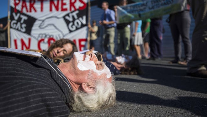 Protesters stage a die-in before the Public Service Board considers a Vermont Gas proposal for an easement to construct a natural gas pipeline through Geprags Community Park in Hinesburg during a hearing in Berlin on Thursday, Aug. 4, 2016.