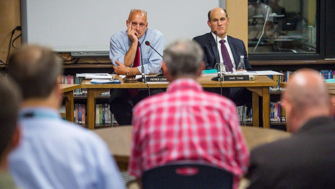Patrick LeDuc, chair of the South Burlington School Board, left, and Superintendent of Schools David Young, right, listen as Bruce Chattman, center, speaks as the board considers a proposed school consolidation plan on Wednesday, September 7, 2016.