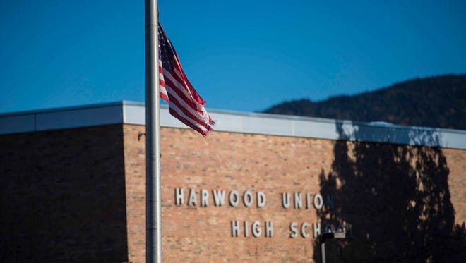 The flag flies at half-staff before a vigil for five high school students killed in a head-on crash on I-89 held at Harwood Union Middle/High School in Duxbory on Monday, October 10, 2016.
