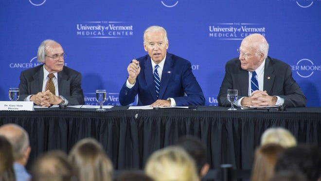 Vice -President Joe Biden speaks during a Cancer Moonshot Roundtable at the University of Vermont in Burlington on Friday, October 21, 2016.  Looking on are Dr. Gary Stein , director of the Vermont Cancer Center, left, and U. S. Senator Patrick Leahy.