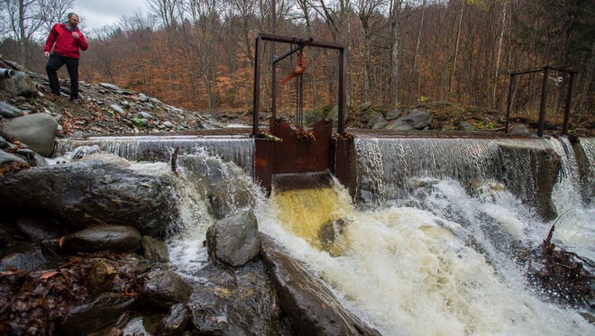 Josh Arneson, vice president of sales and marketing for the Bolton Valley Resort, admires the flow of water in the Joiner Brook in Bolton on Thursday, November 3, 2016. The ski resort has a pumping station next to the brook from where it draws water for snowmaking.  Recent rainfall has replenished the drought-struck brook.