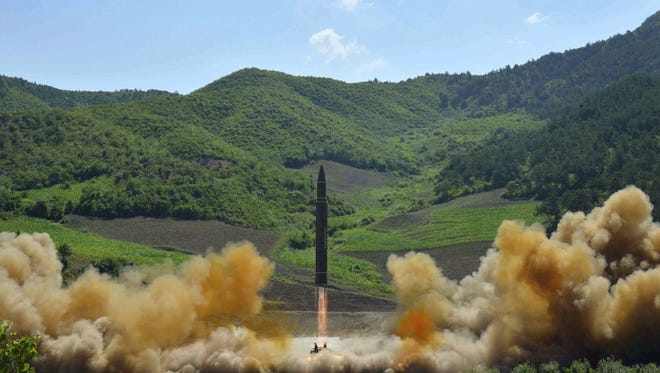 The North Korean government launched a Hwasong-14 intercontinental ballistic missile on July 4. It falls to President Donald Trump to decide on appropriate measures against the rogue nation. FILE- This photo on July 4, 2017, distributed by the North Korean government shows what was said to be the launch of a Hwasong-14 intercontinental ballistic missile, ICBM, in North Korea's northwest. A dictator stands on the verge of possessing nuclear missiles that threaten U.S. shores. A worried world ponders airstrikes and sanctions.