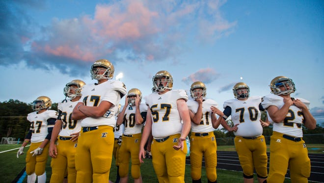 Essex players watch from the sidelines as the Hornets battle the South Burlington Wolves in South Burlington on Friday, September 1, 2017.