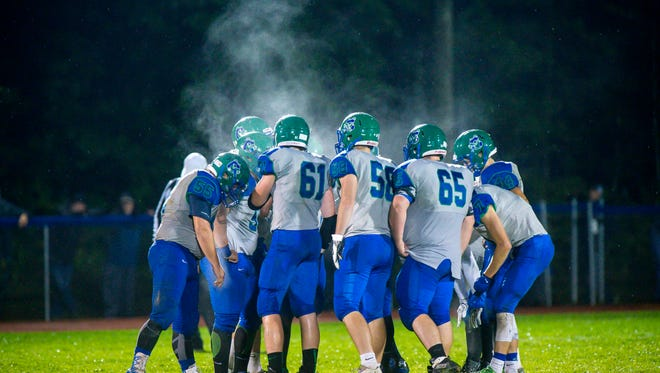 Steam rises from the Colchester huddle as they play South Burlington in the rain in Colchester on Friday, September 8, 2017.