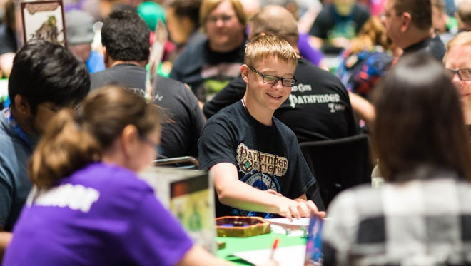 "Attendees at last year's Gen Con 50 at one of the convention's many events. This year, the convention plans to reduce its paper usage and offer ""unboxing stations"" as part of its sustainability efforts kicking off for the 2018 convention."