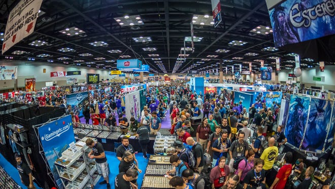 """Attendees walk the floor and explore games at last year's Gen Con 50. This year, the convention plans to reduce its paper usage and offer """"unboxing stations"""" as part of its sustainability efforts kicking off for the 2018 convention."""