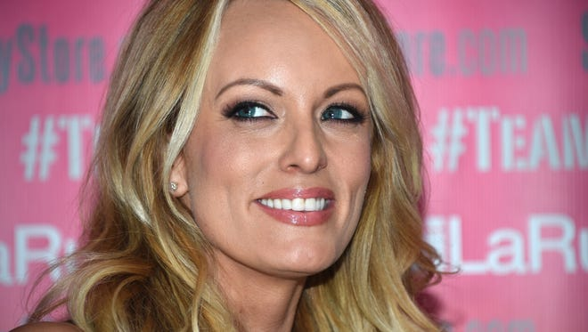 Adult film star Stormy Daniels poses and signs autographs at Chi Chi Larue's adult entertainment store in West Hollywood, California.