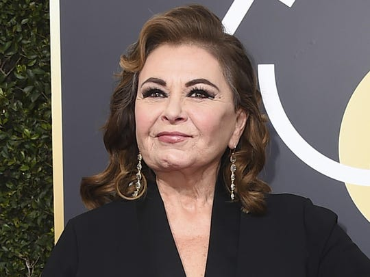 "FILE - In this Jan. 7, 2018 file photo, Roseanne Barr arrives at the 75th annual Golden Globe Awards in Beverly Hills, Calif. Barr is blaming a racist tweet that got her hit show canceled on the insomnia medication Ambien, prompting its maker to respond that ""racism is not a known side effect."" (Photo by Jordan Strauss/Invision/AP, File)"