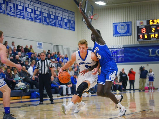 Sioux Falls Christian's Mitchell Goodbary pushes past