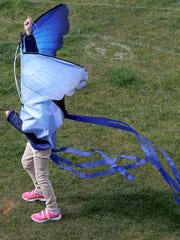 Tiffany Park ,5, of Bremerton, has the wind push her