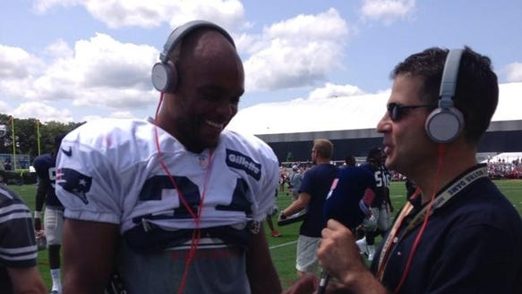 Patriots' play-by-play announcer Bob Socci interviews