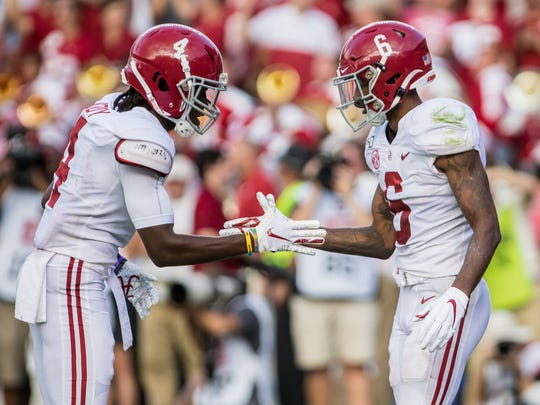 Sep 14, 2019; Columbia, SC, USA; Alabama Crimson Tide wide receiver Jerry Jeudy (4) and wide receiver DeVonta Smith (6) celebrate after a play against the South Carolina Gamecocks at Williams-Brice Stadium. Mandatory Credit: Jeff Blake-USA TODAY Sports
