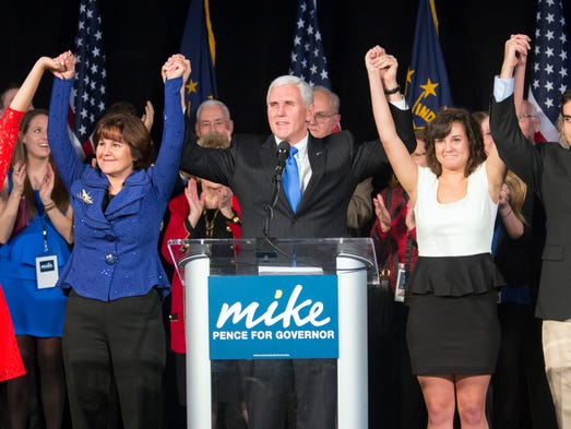 Republican governor-elect Mike Pence, middle, celebrates