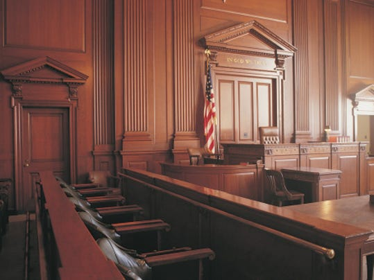 A stock image of a courtroom.