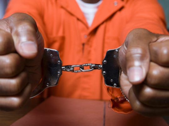 Handcuffs_black_arrests.jpg