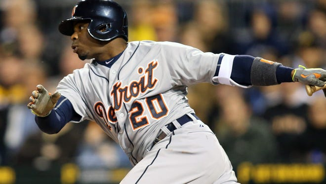 Detroit Tigers centerfielder Rajai Davis (20) hits an RBI single against the Pittsburgh Pirates during the seventh inning at PNC Park.