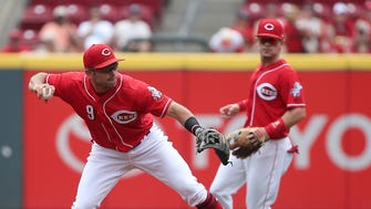 Cincinnati Reds shortstop baseman Jose Peraza (9) throws to first base on a ground ball out in the first inning during the National League baseball game between the Arizona Diamondbacks and the Cincinnati Reds on July 20, 2017, at Great American Ball Park.