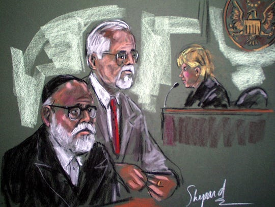 Chaim Berger appearing in 2001 with defense attorney
