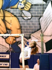 Fort Defiance's Tori Cleveland rises for a spike during