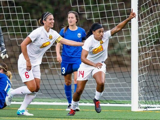 Abby Erceg, Jessica McDonald celebrates scoring