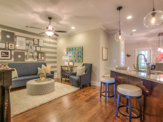 Goodall Homes is offering flex space on the main level that can be used as a formal dining room, an office or as a guest suite.