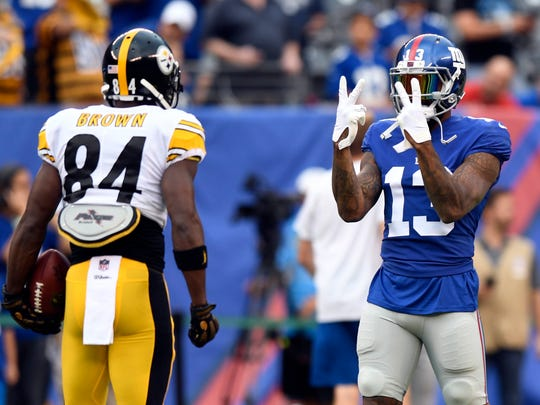 New York Giants wide receiver Odell Beckham (13) and Pittsburgh Steelers wide receiver Antonio Brown (84) talk during warm-ups before their preseason game in East Rutherford, NJ on Friday, August 11, 2017.