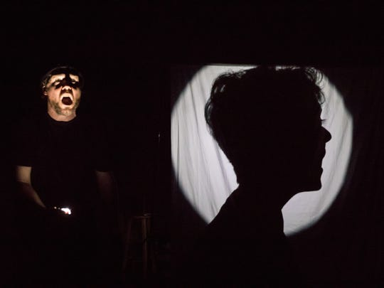 """After several months away from the local stage, Paul Strickland (left) and Erika Kate MacDonald (right, in silhouette) returned with """"13 Dead Dreams of 'Eugene',"""" their take on the mysterious tale of an unidentified man whose body was found beside a lonely road in Sabina, Ohio in 1929."""