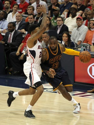 Cleveland Cavaliers forward LeBron James (23) drives against Atlanta Hawks guard Kent Bazemore (24) in Wednesday's Game 1 of the Eastern Conference finals.